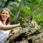 Megs with cute baby tiger on log, Tiger Kingdom, Thailand
