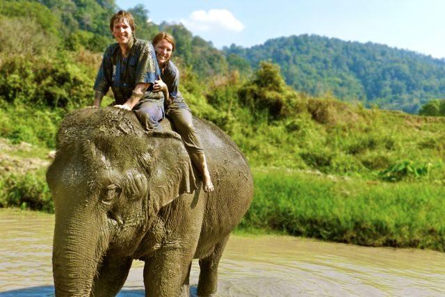 Megsy & Tommo on a muddy elephant